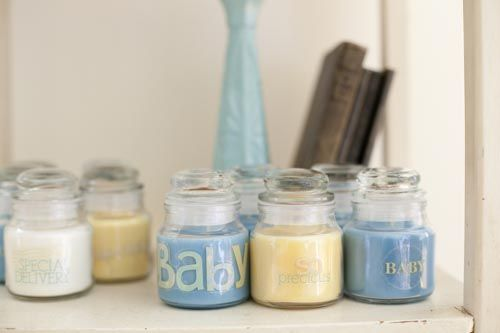A Vintage Blue and Yellow Baby Shower Brings the Garden Inside. For favors, each guest left with a Yankee candle in blue or yellow to celebrate the arrival of baby. They were placed on a wooden table near the wall adding more of the palette of the day to the room.