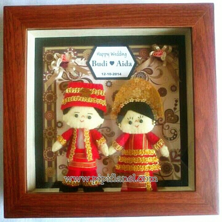 Hi, this cute feltdoll is wearing Padang traditional wedding costume, made by Pipi Flanel.. Wanna see our feltdolls collection? Please visit our website at www.pipiflanel.com thank you :)