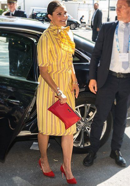 On August 28, 2017, Crown Princess Victoria attends a seminar on Antimicrobial resistance during the World Water Week conference at FH Congress Hall in Stockholm, Sweden. The dress worn by Crown Princess Victoria is an old dress of her mother Queen Silvia. Queen Silvia wore that dress at a state visit to Soviet Union in 1978.
