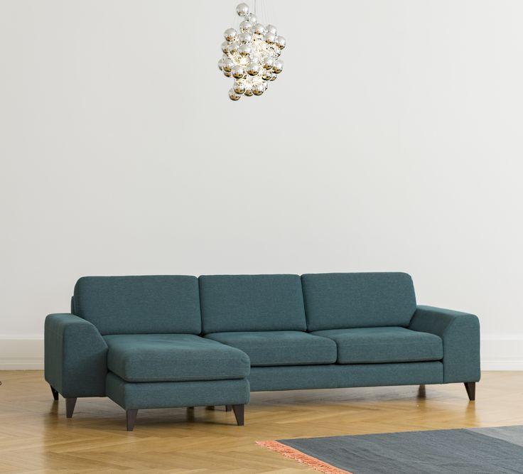 Ancona Chaise Sofa in Dark Green Marengo Light: Stochastic / Luceplan Rug: Normann Copenhagen