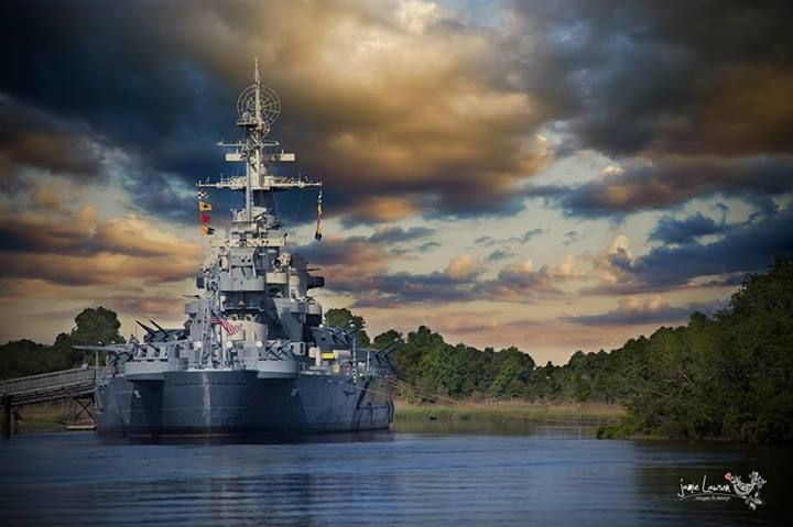USS North Carolina Battleship has been permanently anchored in Wilmington, NC for many years now, but it still proudly flies the flags of battle.