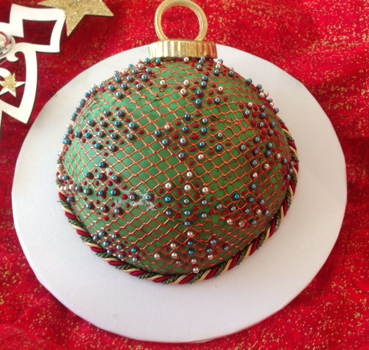 """Silverwood 6"""" sphere ball cake tin used for the fruit cake, Claire Bowman cake lace """"fishnet"""" mat used for the cover"""