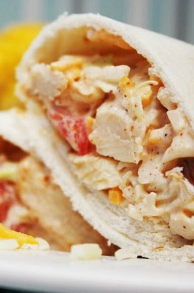 Southwest Chicken Wraps -Chunks of grilled chicken strips and dry cole slaw mix, tossed with chili powder, lime juice, ranch dressing, cheddar cheese, and tomatoes! PERFECT for lunch boxes!