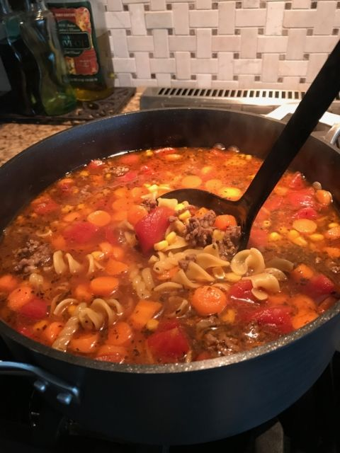 A quick, hearty soup that is packed with tender noodles, veggies, and ground beef. Perfect for cooler Fall/Winter weather!  1 lb ground beef (or turkey) 1/2 cup onion, chopped 2 garlic cloves, minced 4 cups beef broth 3 cups water 14 oz. diced tomatoes (not drained) 1/2 lb uncooked pasta 1/2 cup celery, sliced 1/2 cup carrots, sliced 2 beef bouillon cubes 1/2 tsp Basil 9 oz. frozen mixed veggies In a 4 quart saucepan or dutch oven, brown the beef.  Add the onion and garlic, cooking until…