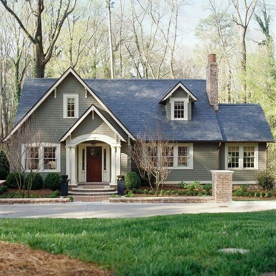 They turned an old cape cod into a cute bungalow just by extending the roof line, adding a cute entrance and repainting. by Marie McConnell