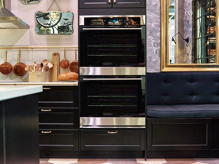 Appliances blend in seamlessly with the LAXARBY black brown cabinets in this kitchen.