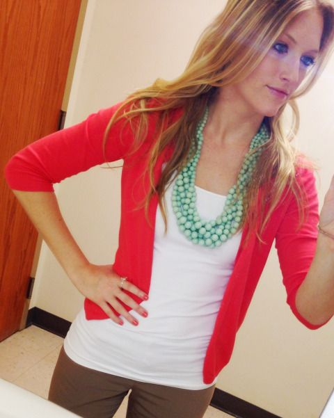 My favorite new (comfy) work outfit: Coral cardigan, mint statement necklace, tan pants.