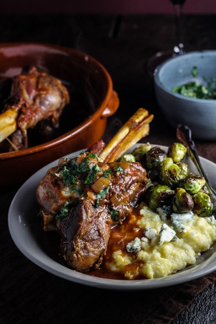 braised lamb shanks with fresh corn and blue cheese polenta, brussels sprouts