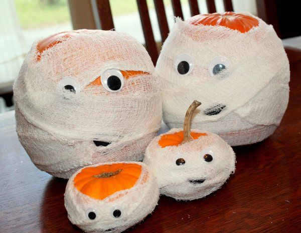 Make a family of pumpkin mummies for Halloween  We did this 10/2013- used a lot mor hot glue and streamer paper. Keeping it inside otherwise definitely need the gauze.-LW