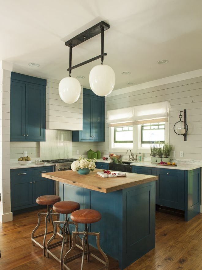 cabinets painted in Olympic's Castile, a bespoke pendant with  glass globes found at an antiques warehouse, and island top made of  reclaimed chestnut