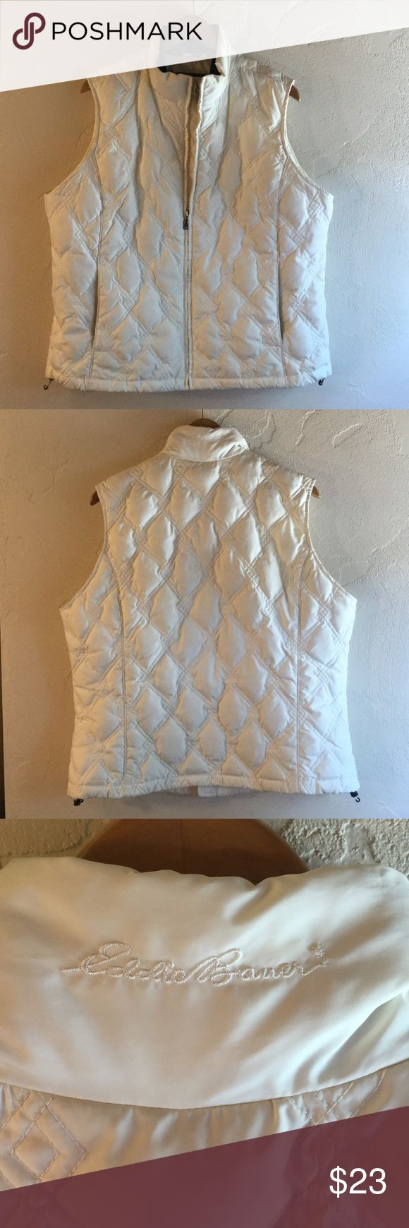 Eddie Bauer Down Filled Puffer Vest XXL This great Eddy Bauer goose down puffer vest is just such a staple piece for the cold weather months. I love it because I think winter whites are so chic! The quilting pattern is so unique and it holds all those little bits of down fluff in place, keeping you cozy all the while. I also love that while it's a puffer it is not super bulky! There are signs of wear. I laundered it myself. It probably needs a trip to the dry cleaners to remove a tiny light…