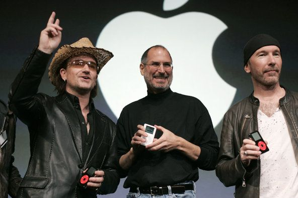 Members of the music group U2, including Bono, left, at an Apple event in 2004 with Steven P. Jobs. The group is expected to play a role in Apple's announcements this week (2014). Credit Peter DaSilva for The New York Times