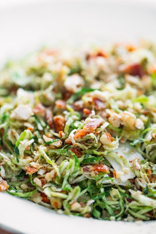 Bacon and Brussels Sprout Salad - paper-thin brussels sprouts with bacon, almonds, Parmesan, and a light citrus vinaigrette. Always everyone's favorite! @pinchofyum