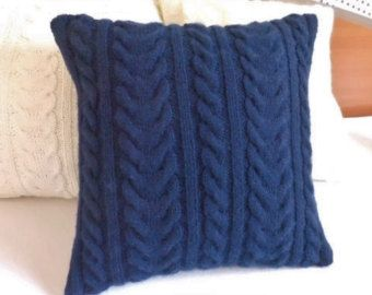This custom navy blue pillow cover has a cable stitch design on front as well as on back, using a rich and soft midnight blue yarn. The indigo colored pillow would look lovely in a contemporary decorated room. To close the pillow case I used my signature envelope style and three handmade crochet buttons.  The design would be a timeless addition to a couch, bed or armchair, and would add a special touch to a room.  Yarn:acrylic Hand wash cold.Lay flat dry.  The case would be ordered to would…
