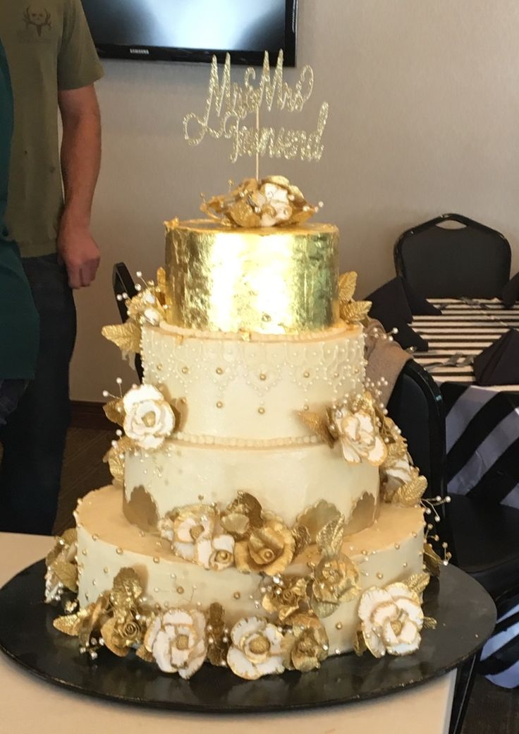 Gold wedding cake with gold gum paste flowers