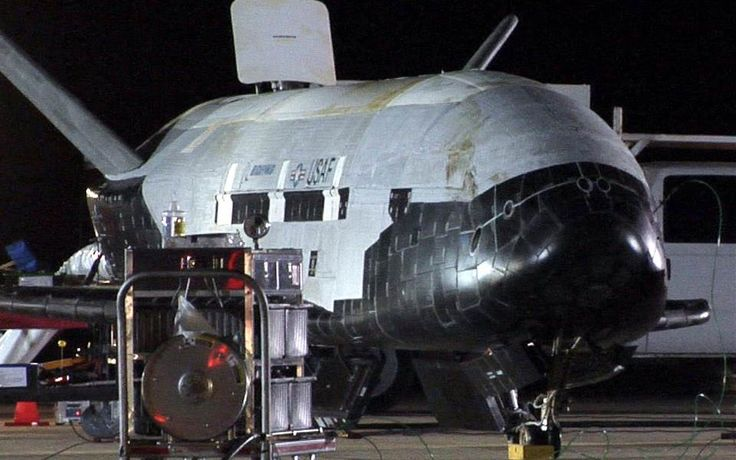 Image: This picture provided by the US Air Force shows the X-37B, the Air Force's first unmanned re-entry spacecraft, after landing on December 3, 2010 at Vandenberg Air Force Base in California.