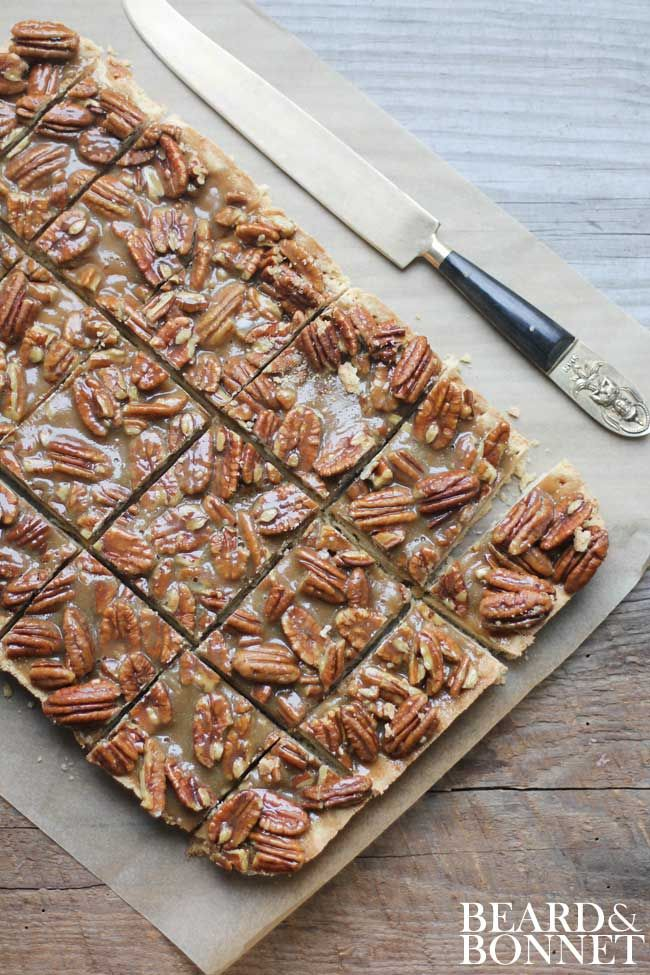 Since it is about to be peak pecan season you should totally add these gluten free Pecan Pie Bars to your must make list! {Beard and Bonnet}