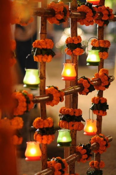 wedding backdrop? genda flowers decor, lantern theme, dim light decor, orange and green lanterns