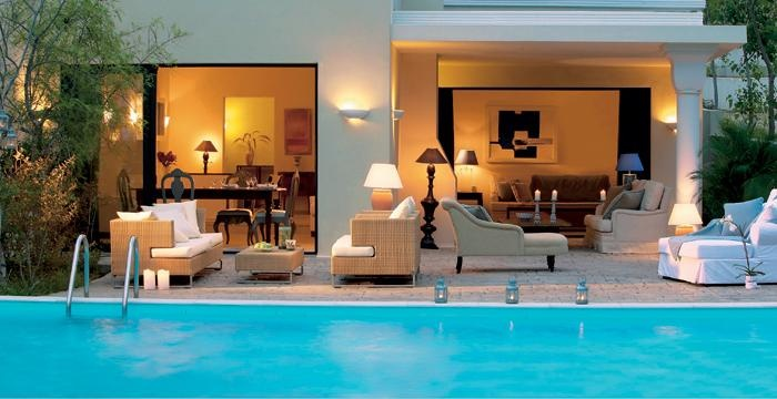 A lovely lounge by the tyrquoise water of the Ideales swimming pool in Grecotel Olympia Riviera in Kyllini