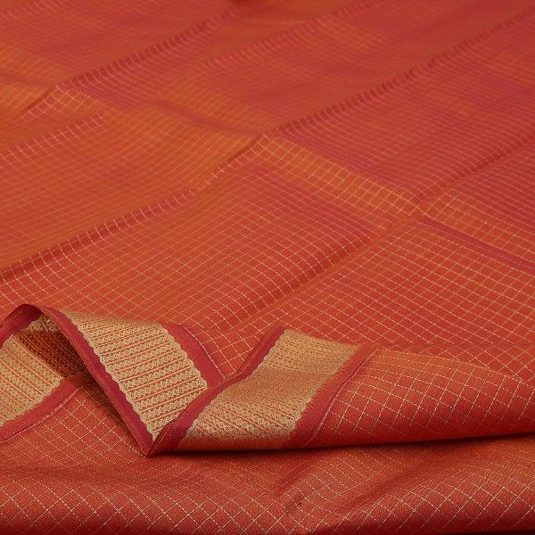 The carrot orange #silk body is veiled in skeins of gold checks to add lustre and sheen. The unusual border echoes a vertical gold weave while the russet pallu is smothered in gold checks with floral, peacock and yali motifs adding to its inherent beauty. This Sarangi Kanjivaram will look enchanting when worn with the plain carrot orange blouse with running border. Handwoven with passion, here is a winner! View Kanjivarams in this shade at #Sarangi. Code 070126649.