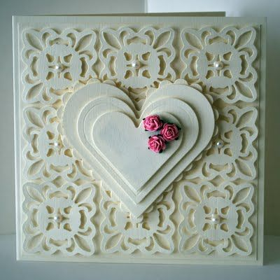 Eileen's Crafty Zone:   spellbinders-fleur-de-lis-pendant-die and classic hearts     (I don't have the fleur-de-lis, but I could accomplish the same thing with Parisian Accents or a Martha Stewart punch all over the page)
