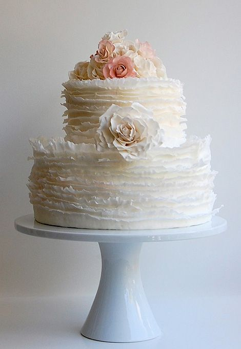 textured wedding cake with floral accents.