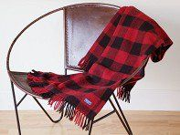 Made to last for a lifetime—the Buffalo Check is a 100% wool blanket made in a 150-year-old Minnesotan mill. This classic plaid throw has a soft fringe finish. The raw wool has natural stain-, wrinkle-, and water-resistant properties that make it easy to care for. The Faribault Mill made over 250,000 blankets for American troops in World War II, and still uses many of the same machines and techniques.