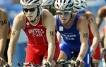 Canada's Simon Whitfield,(16) from Kingston, Ontario, bikes in the cycling portion of the men's triathlon on his way to a silver medal at the 2008 Summer Olympics in Beijing, Tuesday, August 19, 2008.
