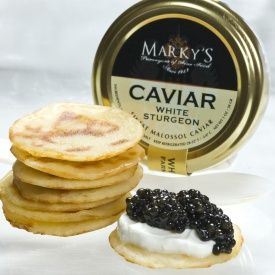 This caviar gift set includes: - 2 oz, American Osetra White Sturgeon Caviar - 8.0 oz, Crème Fraiche - 1 pack - 36 pieces, Mini Blini - Hand Made - optional serving spoon