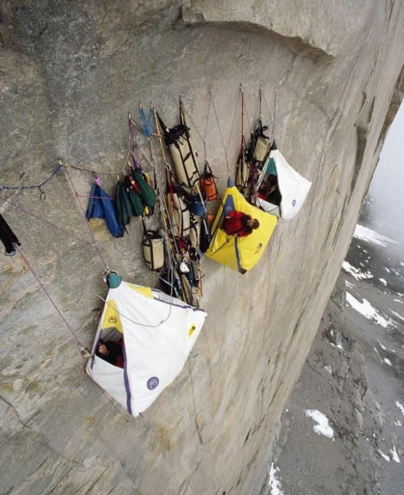 """Cliff camping, Scariest campsite ever!!    In this stunning evening photograph, we see a group of hikers camping out on the famous cliff of Preikestolen in Norway. In English this place may be known as Preacher's Pulpit or Pulpit Rock, or by the old local name, Hyvlatonna (""""the carpenter-plane's blade"""")."""