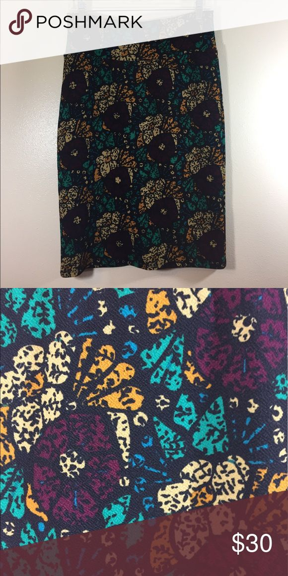 LLR Cassie small EUC Lularoe Cassie skirt, wore once. Black background w/deep plum colored flowers and cream, orange, and teal greenery. LuLaRoe Skirts Pencil