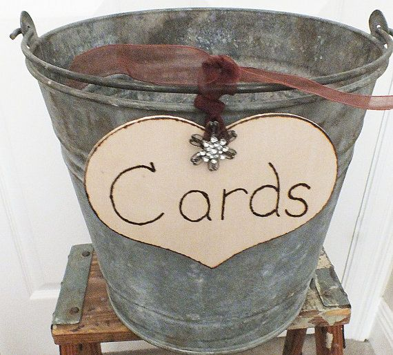Rustic wedding card bucket. Take a wooden heart (Michaels) and tulle/ribbon of your choice. So cute!