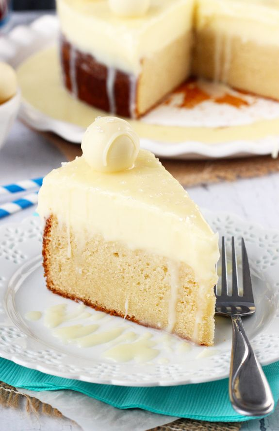 White Chocolate Truffle Cake ~ the dense vanilla cake is a nice contrast to the soft, melt in  your mouth chocolate truffle topping