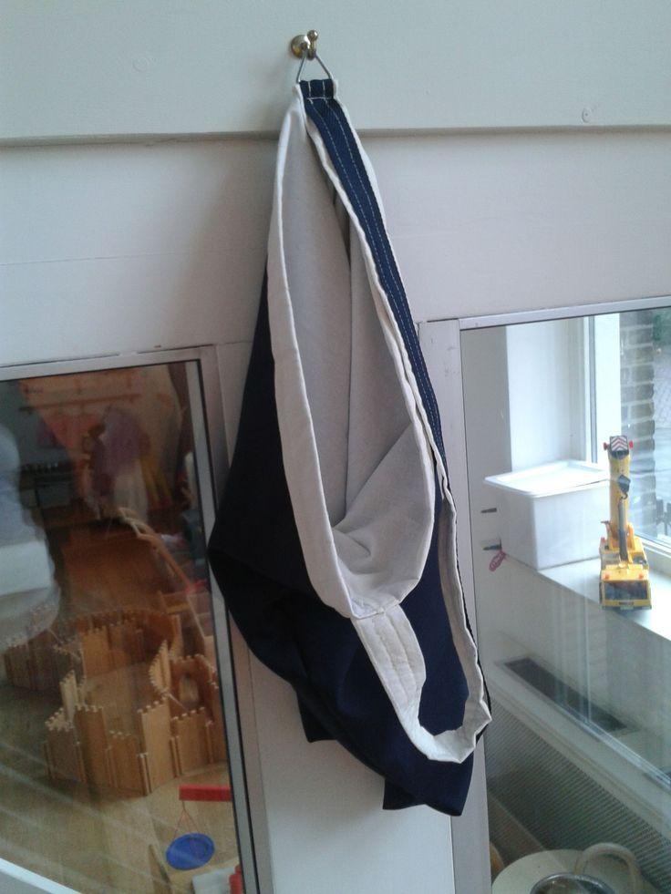 zelf ontworpen en gemaakt: een waszak voor de kinderopvang. In de kleuren van het bedrijf