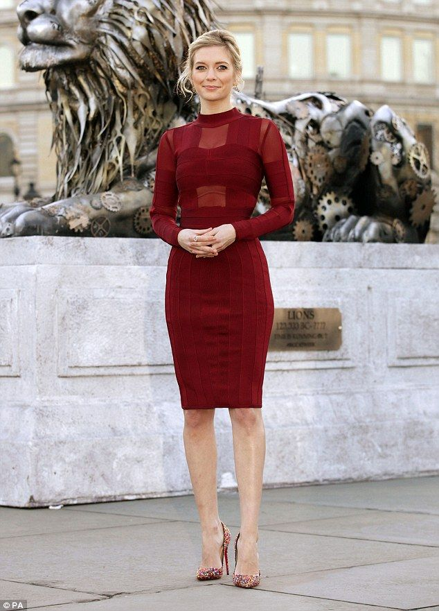 Racy in red: Rachel Riley looked gorgeous in red as she promoted a TV show in London's Tra...