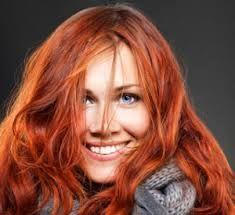 photo de femme aux cheveux teint cuivr cheveux roux ou qui roussissent au soleil - Coloration Roux Cuivr