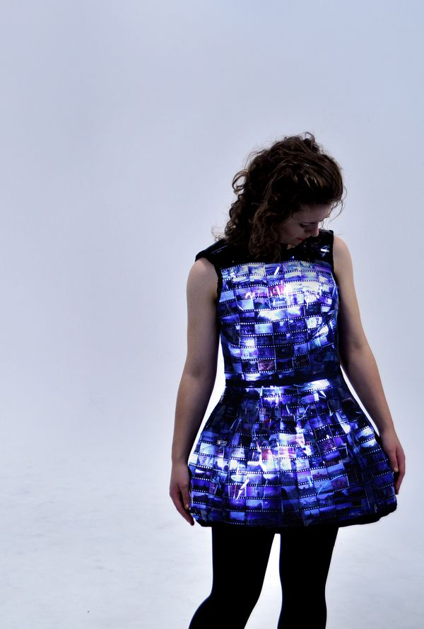 Light-sensitive dress transforms from a shiny black dress to a back-lit slideshow in the dark.
