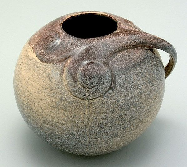 """Dutch art pottery vase, circular form with swirled openwork handle terminating in scrolls, speckled purple and beige glaze, base marked """"Mebach Utrecht"""", script """"500"""" over """"V"""""""