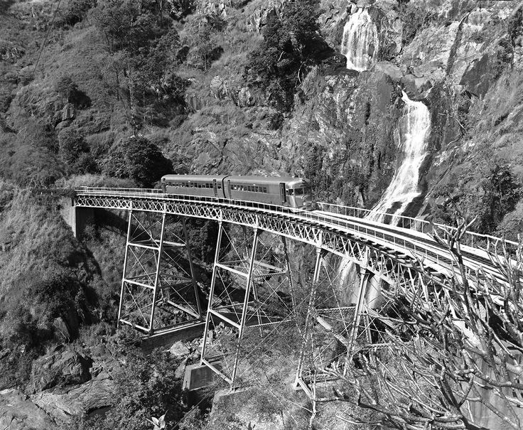The rich colours of the tropics may be missing but the impact of that dramatic rail line never changes. Caption: A 2000 Class Railmotor on Stoney Creek Falls  Bridge, Cairns to Kuranda rail line, 1977.