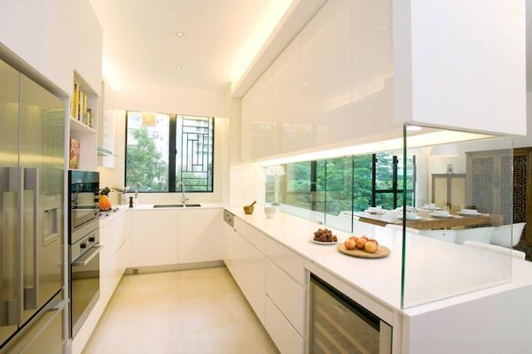 Use glass dividers between the kitchen and adjacent rooms