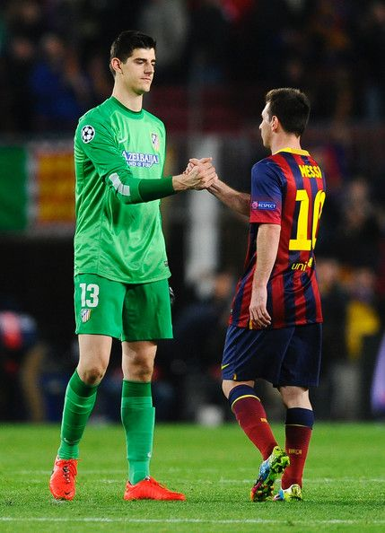 Thibaut Courtois of Club Atletico de Madrid shakes hands with Lionel Messi of Barcelona after the UEFA Champions League Quarter Final first leg match between FC Barcelona and Club Atletico de Madrid at Camp Nou on April 1, 2014 in Barcelona, Catalonia.
