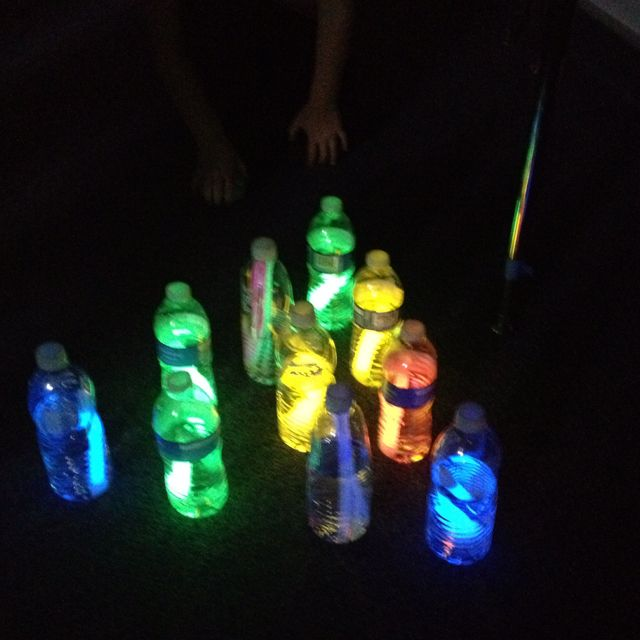 Glow in the dark bowling! glow sticks in water bottles. great idea.
