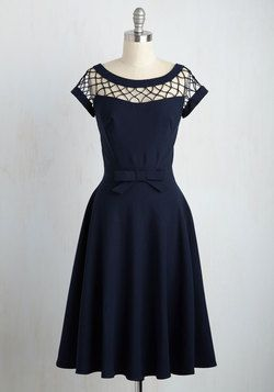 With Only a Wink Dress in Navy. You pride yourself upon being a lady of style…