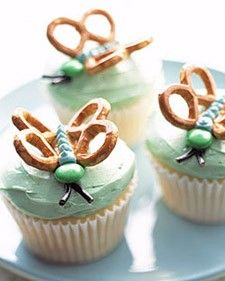 """butterfly cupcakes. A pinner said, """"I would coat the pretzels in white almond bark first."""" Good idea."""