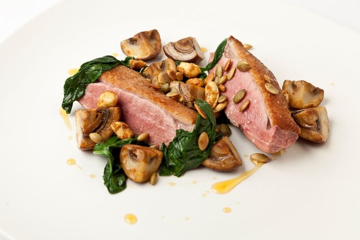 A stunningly simple seared duck breast recipe from Paul Foster is plated up with pumpkin seeds and toasted peanuts