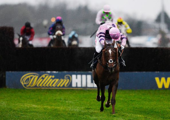 Noel Fehily riding Silviniaco Conti clears the last to win The William Hill King George VI Steeple Chase at Kempton Park racecourse on December 26, 2014 in Sunbury, England.