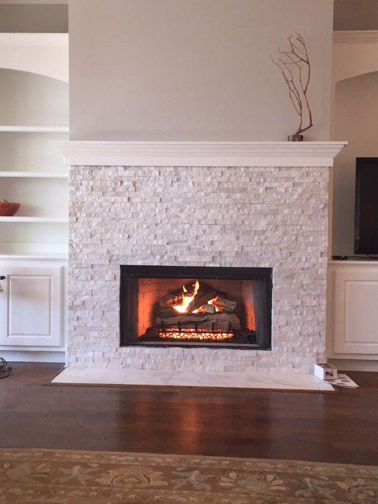 1000 Ideas About White Stone Fireplaces On Pinterest Spacious Living Room Stone Fireplaces