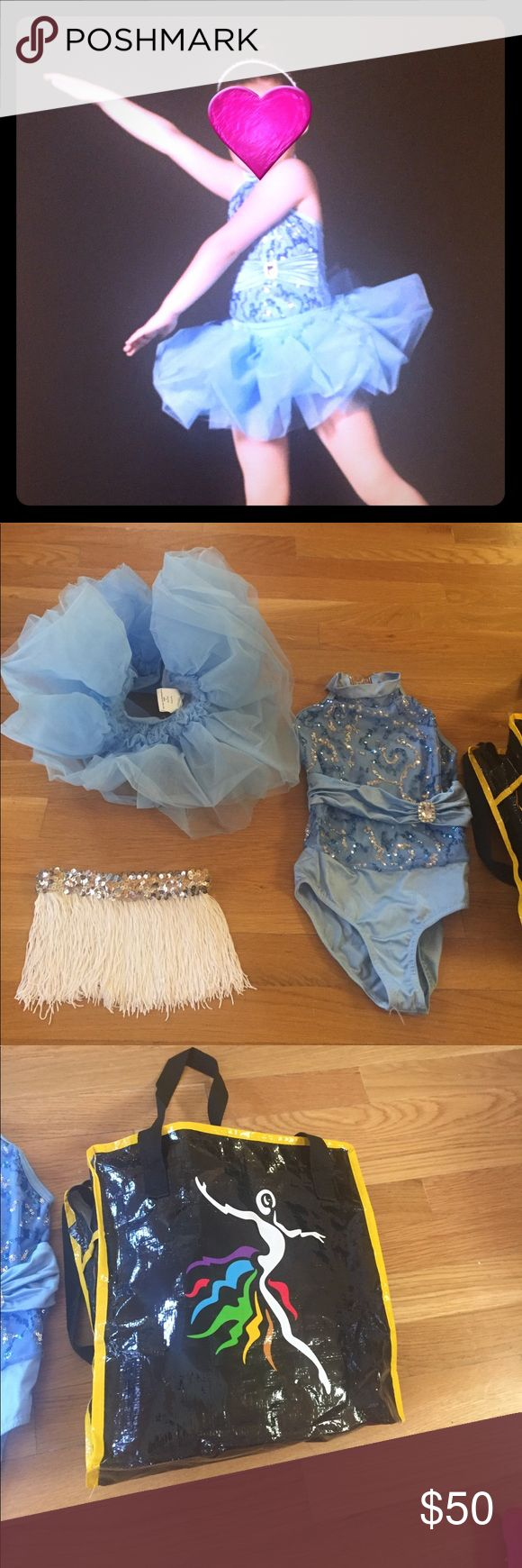Girls dance costume with two skirts and bag Girls dance cotume. Blue with sequin. Size small. With tutu and another string skirt with sequin elastic band. Bag included. Worn twice for rehearsal and show only. Great for dress up Costumes Dance