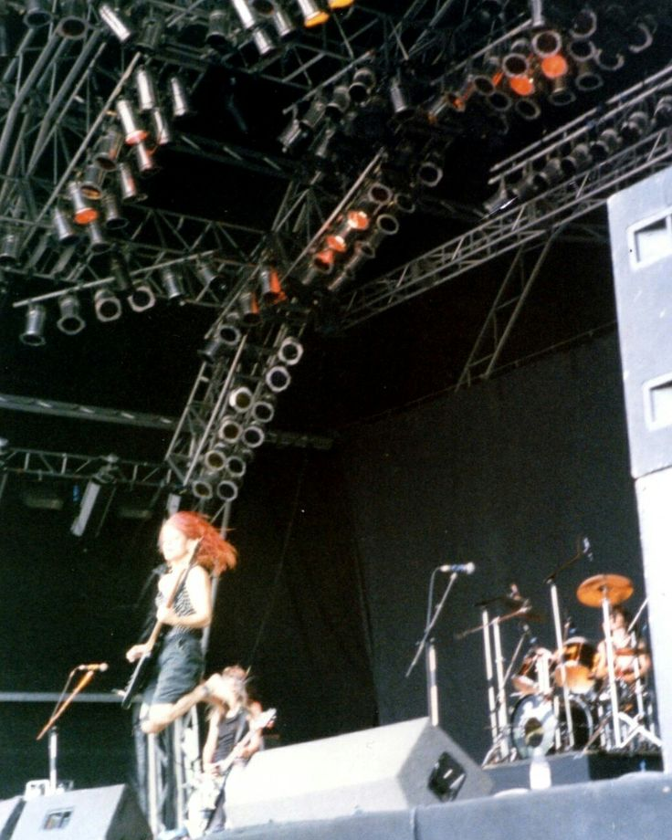 L7 at Reading Festival, August Bank Holiday, 1992 by Sequin World.  This photo, with Jennifer in mid-air, was taken seconds before Donita did that thang