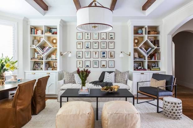 neutral living space with beautiful built ins.